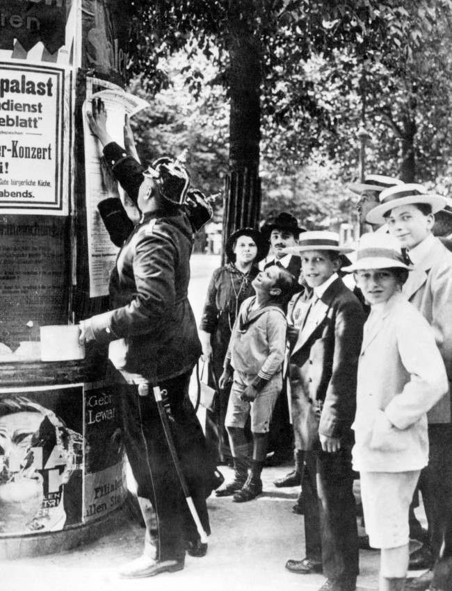 A German policeman posts a mobilisation order in Berlin at the beginning of the First World War.