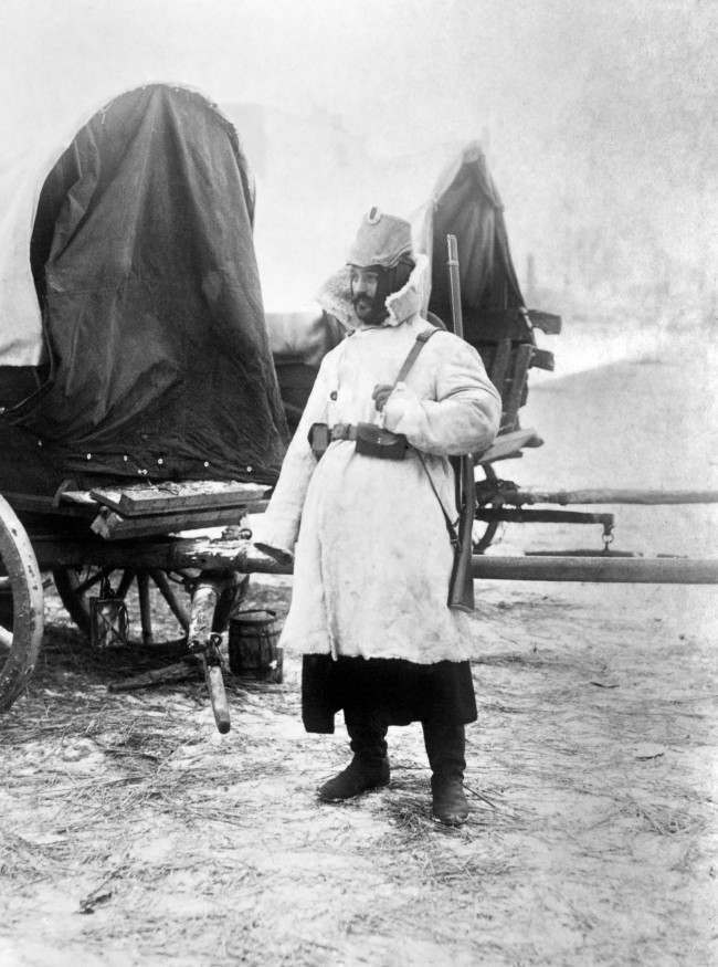 A German soldier of the Landstrum, wearing a fur coat with a Medici collar.