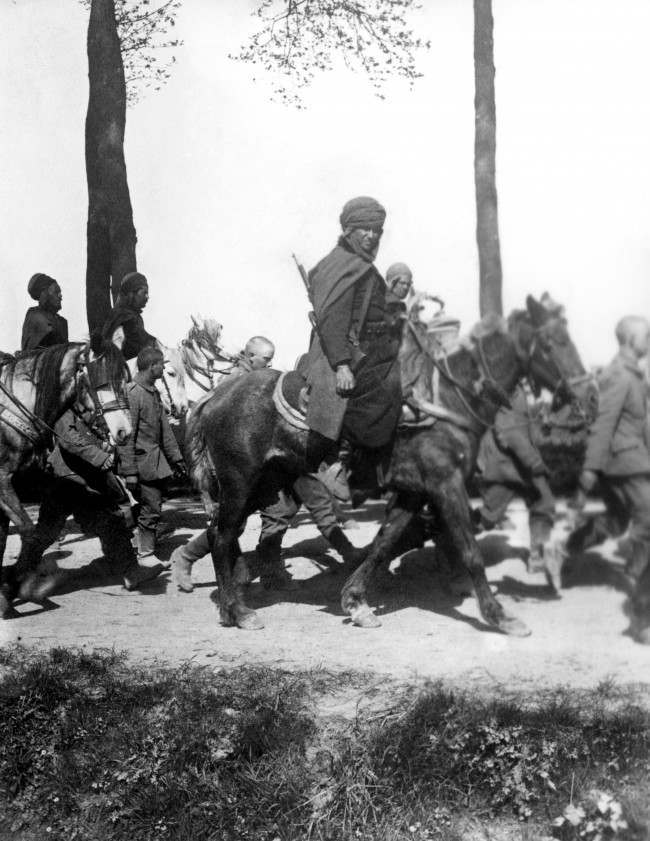 A convoy of German prisoners escorted by French Algerian Sphais, of which there were 14 regiments in the French Army.