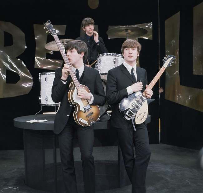 "British rock band the Beatles are shown during rehearsals on the set of the ""Ed Sullivan Show"" in New York, Feb. 9, 1964. On drums is Ringo Starr, bassist is Paul McCartney, left, and guitarist is John Lennon. (AP Photo)"