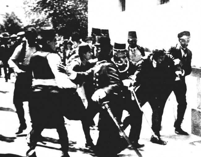 After his bullets had slain the Archduke Franz Ferdinand, GAVRILO PRINCIP is arrested in Sarajevo on Sunday, June 18, 1914. This picture has been reprinted countless times, but last year Yugoslav newspaper alleged that the man is not Princip but an innocent bystander who was arrested in error. Princip, a 19-year-old student, was sentenced to 20 years' imprisonment but after four years died of TB. His bullets, which cut down the Archduke and his wife, Sophie, led to the outbreak of the first World War.