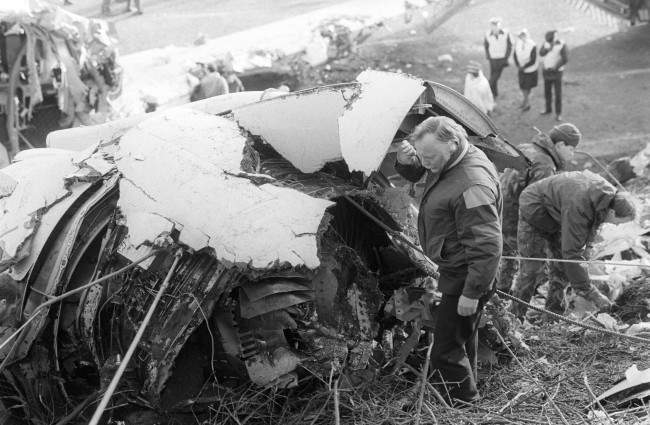 The right engine of the crashed Boeing 737 is inspected by Mr Ed Trimble, principal engineering inspector of the Department of Transport's Air Accident Investigation Branch at the scene of Sunday's crash on the M1 motorway near Kegworth, Leicestershire. Date: 11/01/1989