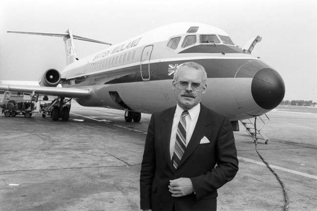 British Midland airline's chairman Mr Michael Bishop in front of a DC9 aircraft.