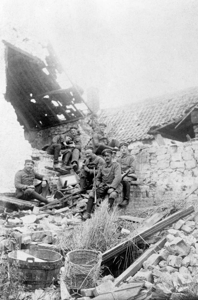 German troops relax in a ruined farmhouse during their occupation of Loos