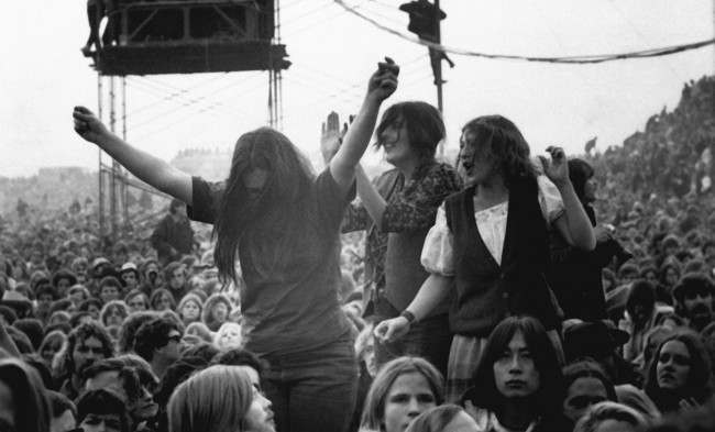 Music fans dance and sing to the Rolling Stones at a free concert at the Altamont Speedway near Livermore, Ca.