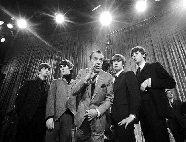 "Ed Sullivan, center, stands with The Beatles during a rehearsal for the British group's first American appearance, on the ""Ed Sullivan Show,"" in New York. Feb. 9th, 1964. From left: Ringo Starr, George Harrison, Sullivan, John Lennon and Paul McCartney. The rock 'n' roll band known as ""The Fab Four"" was seen by 70 million viewers. ""Beatlemania"" swept the charts with twenty No.1 hits and more than 100 million records sold. The Beatles broke up in 1970. (AP Photo)"
