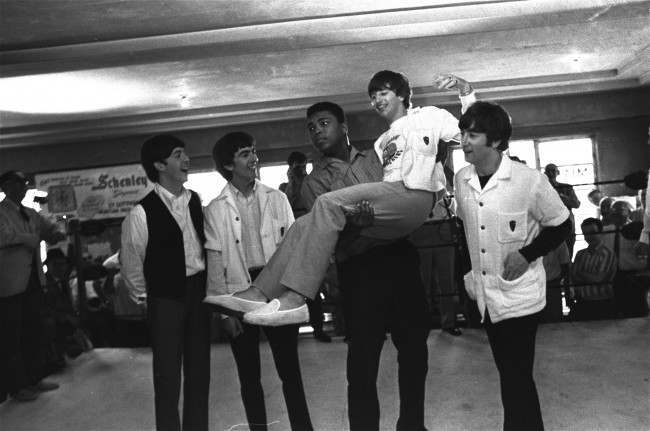 Boxer Cassius Clay lifts Ringo Starr, one of the Beatles into the air while the singers visited Clay's camp in Miami Beach, Fla. February, 18th, 1964. Others are, from left: Paul McCartney, George Harrison, and John Lennon. (AP Photo)