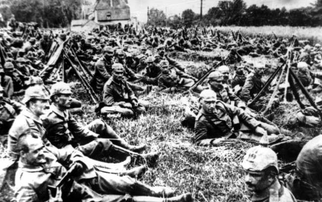 In this undated photo German soldiers resting near Ypres, Belgium on the way to the Flanders battle front during World War I.