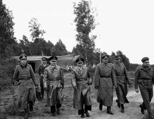 Senior German officers, from left, Maj. Friedel, Rear Adm. Wagner, Adm. Hans-Georg Von Friedeburg, Gen. Eberhard Kinzel and Col. Pollek, arrive at Montgomery's 21st Army Group headquarters, at Luneburg Heath, May 4, 1945. The peace envoy later agreed a surrender pact in the form of a ceasefire on the British fronts in north west Germany, Denmark and Holland as from 8am on May 5.
