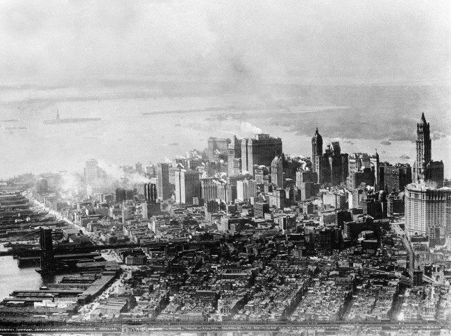 This aerial view shows lower Manhattan, New York City, in 1928. At far right is the tower of the Woolworth building and in left center is the Statue of Liberty on Liberty Island. The Manhattan Bridge is in the foreground and the Brooklyn Bridge is at center. (AP Photo)