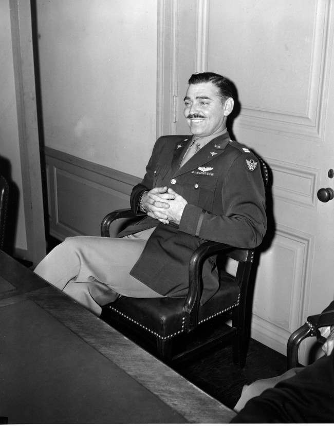 Capt. Clark Gable, erstwhile film actor, faced the press in the Pentagon in Washington, Oct. 27, 1943. Gable flew operational missions over Europe in B-17s to obtain combat film footage to be used for training purposes, and has just returned to the U.S. (AP Photo/Gene Abbott)