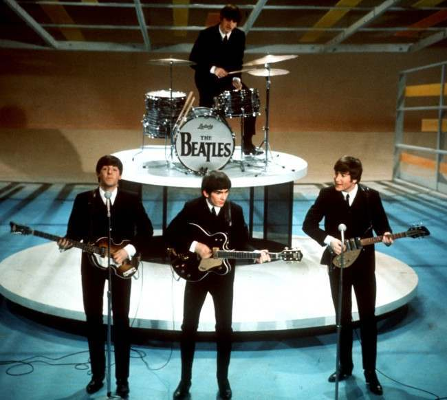 "The Beatles perform on the CBS ""Ed Sullivan Show"" in New York, in this Feb. 9, 1964, file photo. From left, front, are Paul McCartney, George Harrison and John Lennon. Ringo Starr plays drums in the background. The Beatles' ""Love"" album is being released on Nov. 21, and is a thorough reinterpretation of their work. (AP Photo/FILE)"