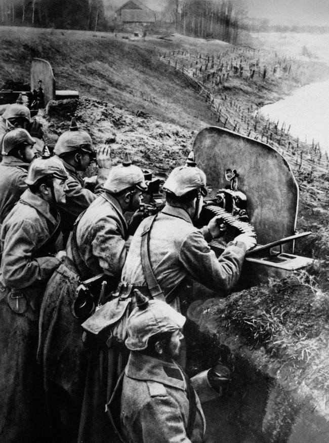 Ready for Russian rush - The Germans had better arms and better transportation than the Russians in World War I. Their machine guns devastated the masses of Russians rushing at them in attack. By the end of the first winter one Russian in four went into the field without a gun. Here German infantrymen aim their machine guns at the Russians from a trench at the Vistula River in Russia, in 1916.
