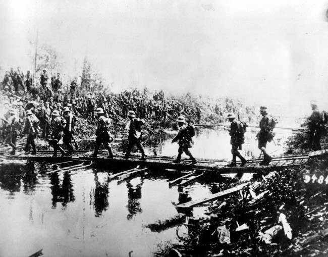 German troops pass over a temporary bridge at the western front in this undated photo during World War I.