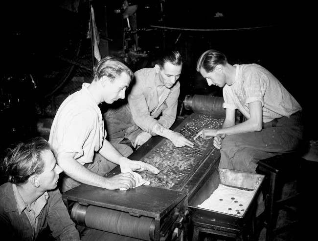 Royal Mint - London - 1949 Sorting blanks for die stamping of sovereigns at the Royal Mint.