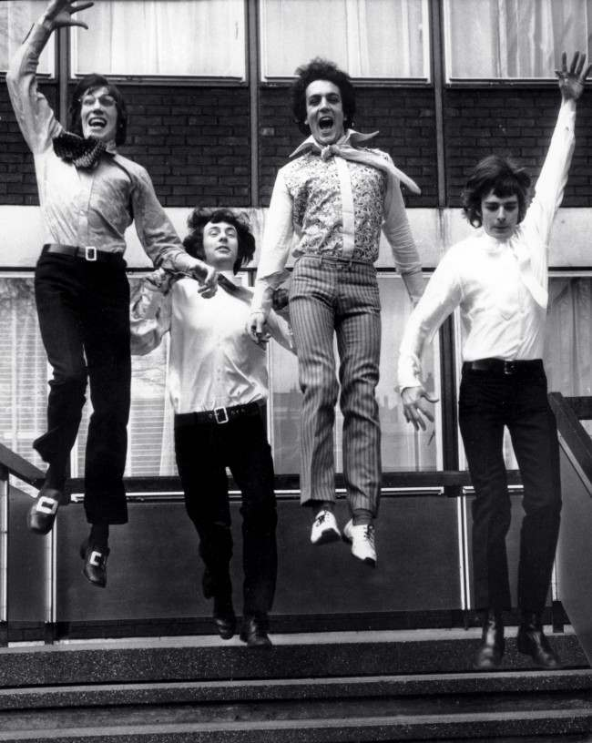 March 3, 1967, members of the rock band Pink Floyd, Roger Waters, left, Nick Mason, second from left, Syd Barrett, second from right, and Richard Wright, right, leap from the steps of EMI House in London.