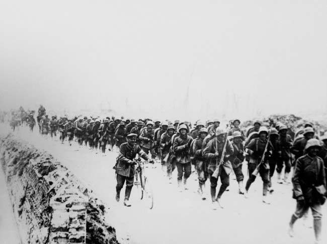 German troops advancing at the western front in 1918. Most of the boys are very young.