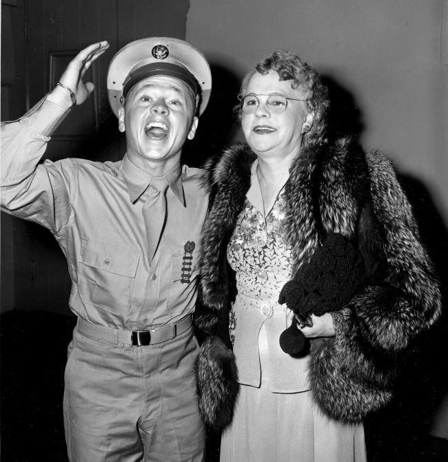 Pvt. Mickey Rooney attends a Hollywood movie premiere with his mother, Nell Pankey, on Aug. 17, 1944. The actor is back in Hollywood after completing three months of basic training at Fort Riley, Kansas. (AP Photo)