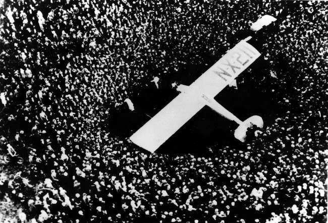 The Spirit of St. Louis is shown in this aerial photo as a crowd surrounds the monoplane after American aviator Charles A. Lindbergh completed the first nonstop transatlantic flight at Le Bourget Airfield near Paris, France, Saturday, May 21, 1927. Lindbergh left Roosevelt Field in New York at 7:52 a.m. on May 20 and landed at Le Bourget at 5:24 p.m., Paris time, after a flight of 33 hours 32 minutes. (AP Photo)