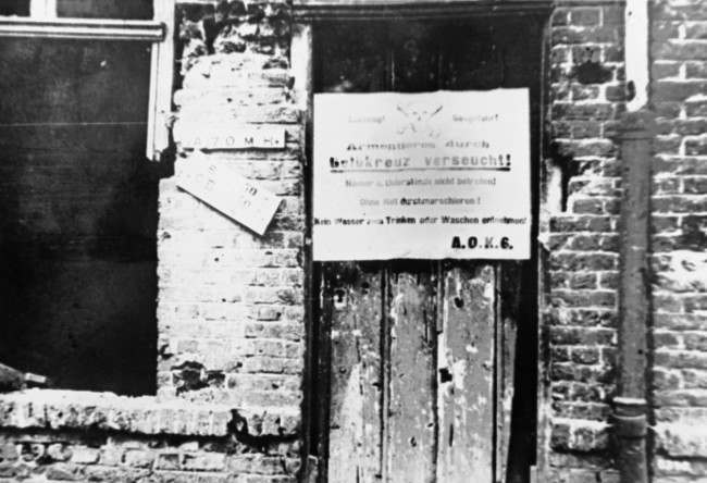 The gas war starts: German notices are posted up by German troops who fought at Armentiere, France in an undated photo, warning their comrades not to enter any houses or dug outs nor to drink the water. (AP Photo)