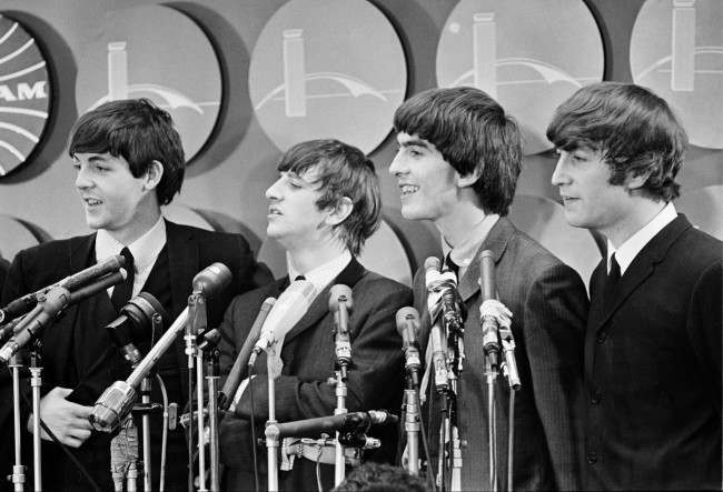 The Beatles meet reporters at Kennedy Airport in New York City, Feb. 7, 1964 on their arrival from London for their first American tour. The band members, from left, are, Paul McCartney, Ringo Starr, George Harrison, and John Lennon. (AP Photo)