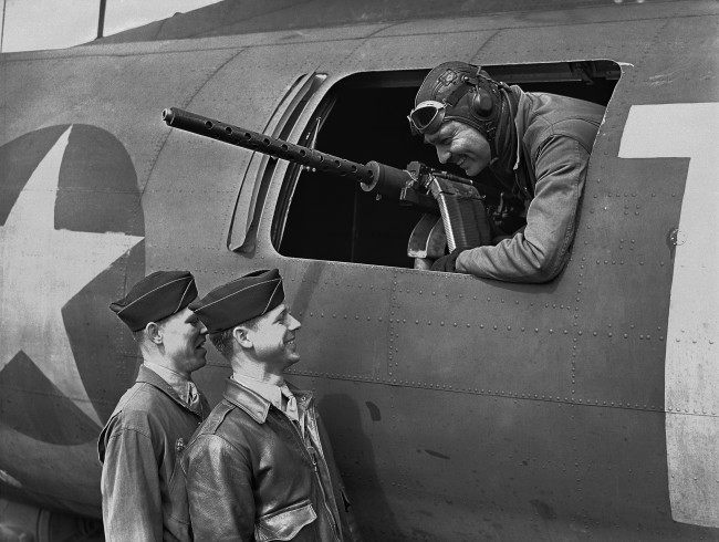 American film star Clark Gable at the waist gun position of his Flying Fortress, on an airfield somewhere in England on June 5, 1943, talking to Sergeant Gunner Kenneth Huls, left, and Sergeant Gunner Phillip Hulse. (AP Photo)