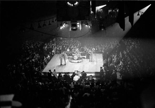 The Beatles perform at the Coliseum in Washington, D.C., Feb. 12, 1964, during their first American tour. The British band members are, in foreground, Paul McCartney and John Lennon; Ringo Starr on drums; and George Harrison on guitar, far right. (AP Photo)