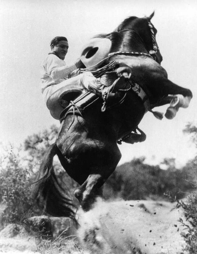 Hollywood western film duo actor Tom Mix and his horse Tony perform a stunt on May 1, 1923. (AP Photo)