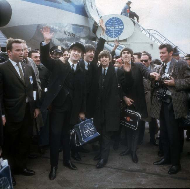The Beatles arrive at New York's Kennedy Airport Feb. 7, 1964 for their first U.S. appearance. From left are: John Lennon, Paul McCartney, Ringo Starr and George Harrison. (AP Photo)