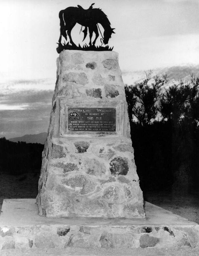A monument marks the site of the fatal car accident that killed Western movie star Tom Mix, seen here on November 26, 1949. The bronze statue of a horse with an empty saddle, symbolizing Mix's horse Tony, is located along highway 80-89, between Florence and Tucson, Arizona. (AP Photo)
