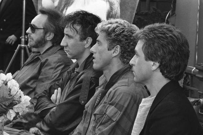 "Members of 'The Who"" rock group listen to questions at news conference in Los Angeles. Friday, Oct. 29, 1982 before start of their concert at the Los Angeles Coliseum. From left are John Entwistle, Peter Townshend, Roger Daltrey and Kenney Jones. The Who are currently on a 32 city, 34 concert tour of North American."