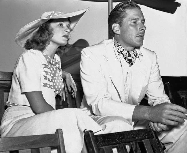 Errol Flynn, swashbucklering hero of the films, is as he attended the Pacific Southwest Tennis Tournament with his actress wife, Lili Damita Sept. 19, 1937. (AP Photo)