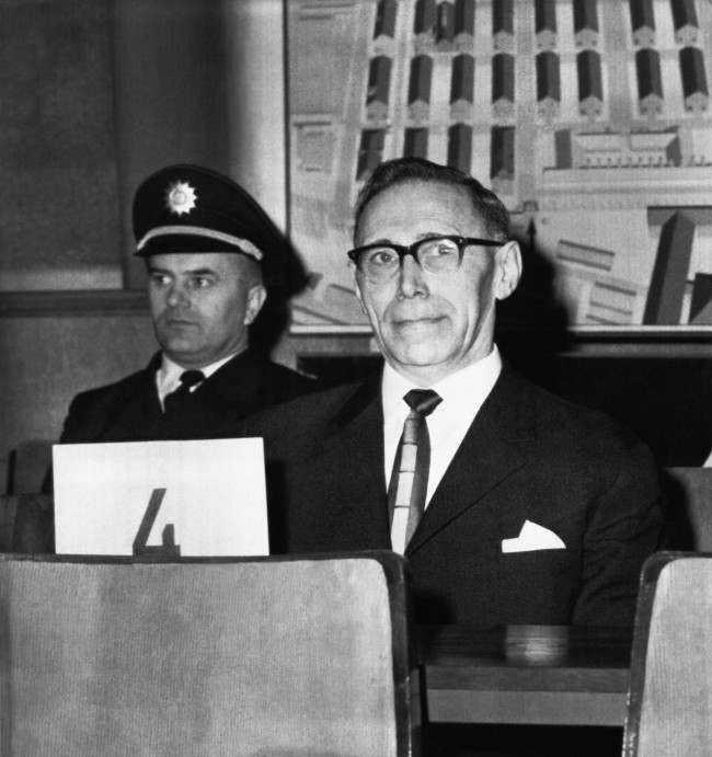 """Auschwitz Concentration Camp SS-guard Wilhelm Boger, 56, pictured in Frankfurt on April 3, 1964, where he is on trial for war crimes. Witness Maximillian Sternol, 70, testified that Boger, named by his former prisoners """"the devil of Auschwitz"""", supervised the slaughter of 2,349 Jewish men, women and children who composed a special section of Auschwitz reserved for families, and the liquidation of thousands of the camps gypsies in the summer of 1944. Asked by the prosecution how he knew that exactly 2,439 Jews were killed in one action alone, Sternol answered: """"'i'll never forget that number for as long as I live, because Boger made me count each and every one of his candidates as they were loaded onto the trucks that took them to the gas chambers."""""""