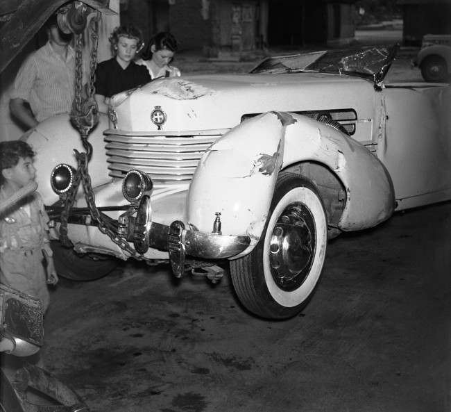 The big racing-type automobile in which Tom Mix cowboy actor, was killed in a highway accident near a Arizona on October 12 is picture after it was to intended in Florence garage on Oct. 16, 1940. Mix was pinned under the over turned partially wrecked car. An eye-witness said Mix was at high speed when his car hit a dirt before rolling over. (AP Photo/Harold Filan)
