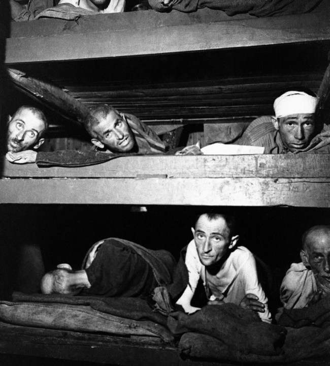 Most of these prisoners are Russian and Polish Jews, just a few manage to raise themselves for the photographer on April 25, 1945 at Buchenwald concentration camp, Germany. The pained expression on the face of the one at extreme left, denotes the agony he is in. (AP Photo)