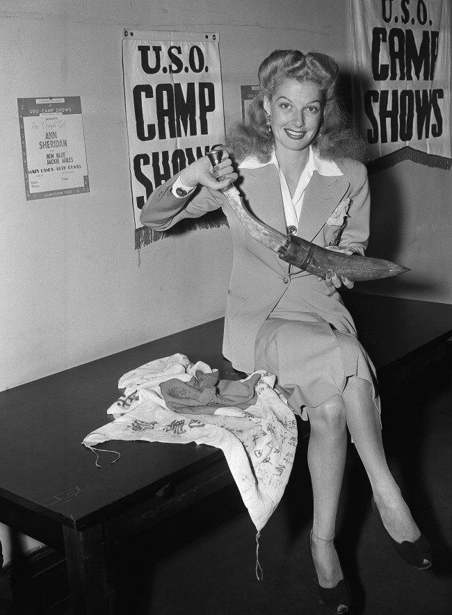 Film actress Ann Sheridan holds a knife used by the Gurkhas, Indian jungle fighters, she brought back from her 60,000 mile USO camp show tour of the Mediterranean theater of operations, India, China and Burma, in New York on Sept. 8, 1944. (AP Photo/John Lindsay)