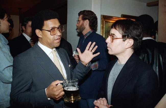 Rev. Allan Boesak of South Africa, left, meets with entertainer Paul Simon at the home of Jane Fonda and Tom Hayden in Santa Monica, Calif., March 10, 1987. (AP Photo/Mark Avery)