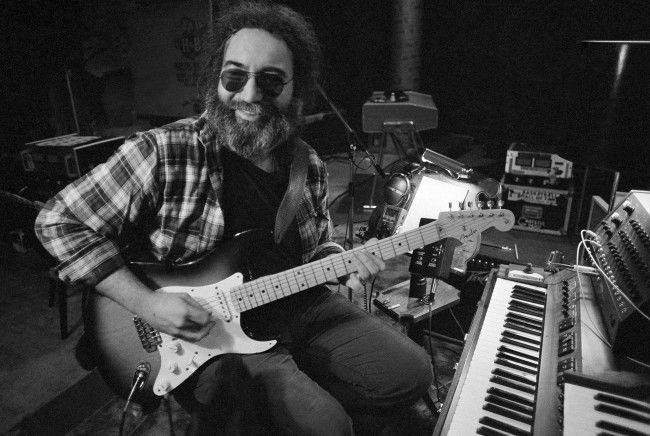 "Jerry Garcia, leader of the legendary group ""The Grateful Dead,"" works with his guitar on May 8, 1979. At the time of the Woodstock Festival, many group had an uncertain future. """"Musically, it was a total disaster for us,"" Garcia said of Woodstock in a interview. """"I remember people standing in back of us yelling the stage is falling down, plus it was wet for so long and we had all that electronic equipment."""" (AP Photo)"