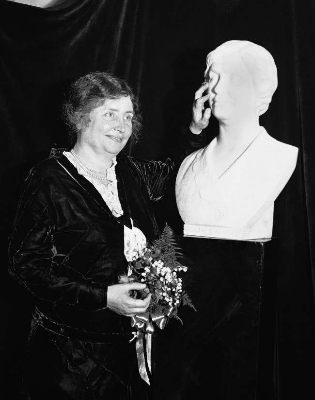 Miss Helen Keller, probably the most famous blind woman in the world, photographed in New York City on Oct. 29, 1931 with a bust of herself sculptured by count Hans-Albrecht Hafrach of Munich, Germany. The bust was presented to the American Foundation for the Blind by M.C. Migel, president of the American Foundation for the Blind, to pay a tribute to the work of Miss Keller for the organization.