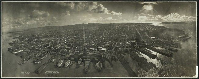 Photograph of San Francisco in ruins from Lawrence Captive Airship, 2000 feet above San Francisco Bay overlooking water front. Sunset over Golden Gate