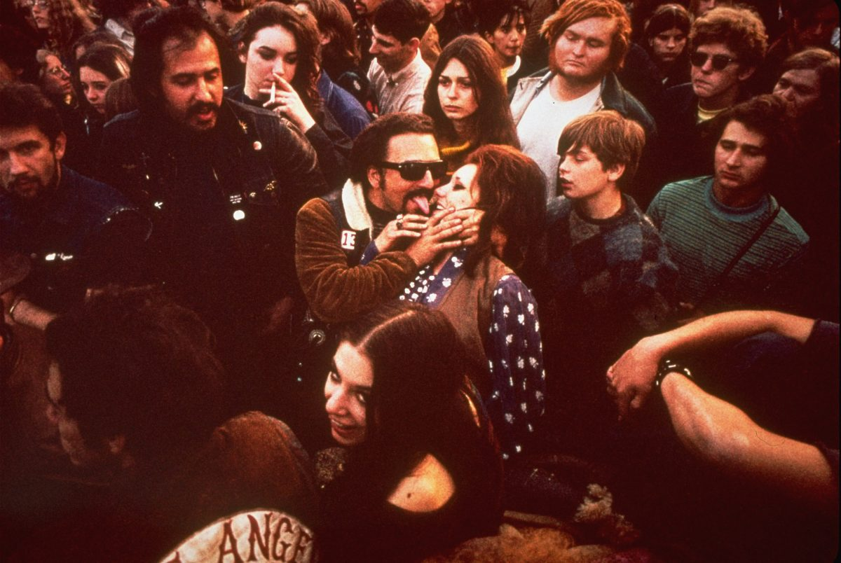 "Fans enjoy themselves at the infamous ""Gimme Shelter"" rock concert featuring the Rolling Stones, at the Altamont Speedway in Livermore, Ca. Later, a fan was stabbed to death by a member of the Hells Angels motorcycle club 8 Dec 1969"