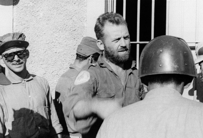 January 5, 1959, William Alexander Morgan, a native of Ohio, is shown in battle dress with Fidel Castro's forces in Las Villas province. Morgan, 30, is a major and is second in command of Second National front and commander of Cienfuegos garrison.