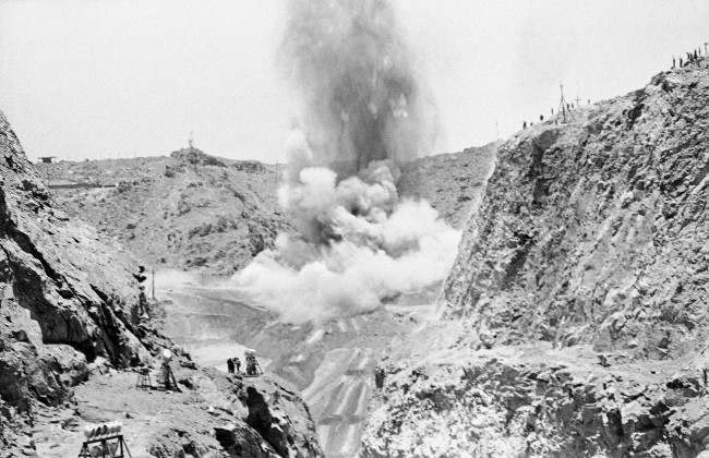 The dynamite blast that removed the last sand barrier for a diversionary canal for the Nile Rivers, around the Aswan Dam in Aswan, Egypt on May 14, 1964. The explosion was set off by Soviet Premier Khrushchev, Egyptian President Nasser, President Aref of Iraq and Yemeni President Sallal. The diversion of the river will allow completion on the Aswan Dam and construction of a huge electric power plant, after which the Nile will be rerouted to its old bed to create a large artificial lake above the dam.