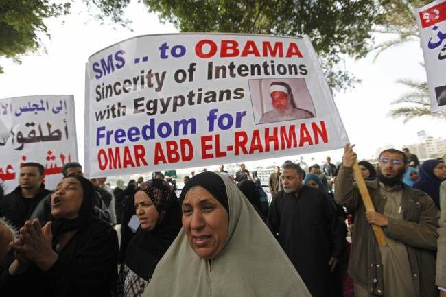 Demonstrators hold a banner demanding the release of Sheik Omar Abdel-Rahman, sentenced to life in prison in the U.S, during a protest in Cairo, Egypt, Sunday Feb. 20, 2011. The protest was also to demand the release of political prisoners in Egyptian jails and anti-government protestors arrested last week that are still in custody.