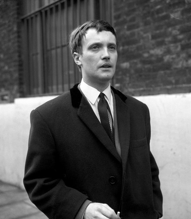 Pop music guitarist Jet Harris, who pleaded guilty at Marylebone to assaulting a company director by pointing a gun at him. Harris, who was charged under his real name of Terence Harris, said that when he held up five people in the foyer of a block of flats, he did so for a joke.  Date: 09/03/1965
