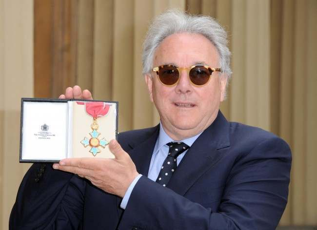 Record producer Trevor Horn poses in the Quadrangle of Buckingham Palace, London after being presented with a Commander of the British Empire (CBE) by the Prince of Wales. Picture date: Wednesday May 11 2011.