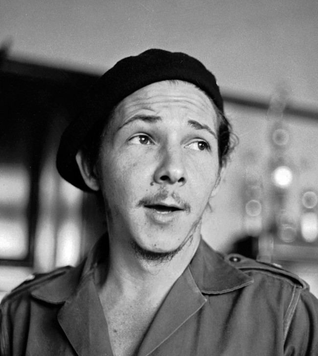 his January 1959 file photo shows the younger brother of Cuba's revolutionary leader Fidel Castro, Raul Castro, as a young guerilla soldier in an undisclosed location in Cuba. Raul Castro, now the current leader of the Communist-run island