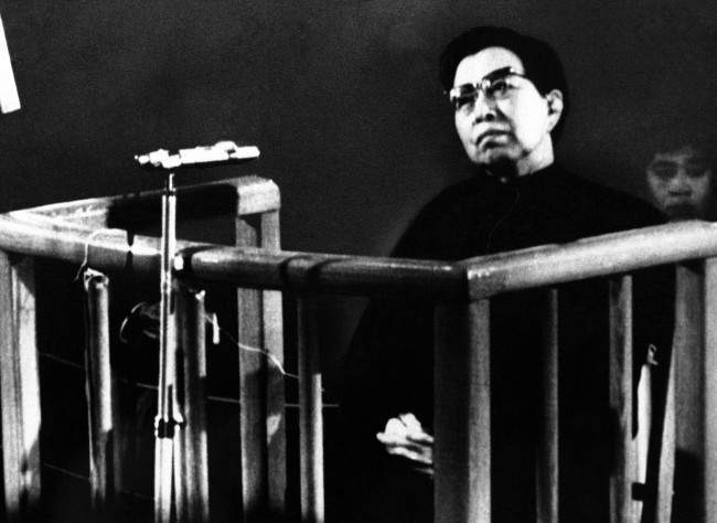 "Jiang Qing, widow of former Chairman Mao, stands trial before a special court of the People's Supreme Court in Peking on Wednesday, Nov. 26, 1980. Jiang refused to confess and defiantly answered, ""I don't Know at all,"" to charges that she plotted against the late Premier Chou En-lai and slandered his protege Deng Xiaoping, China's strongman"