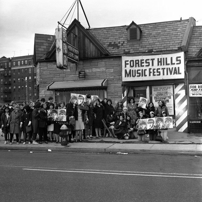 Teenaged girls, after waiting through the night at the Forest Hills Music Festival ticket office in New York, are still waiting on the sidewalk, on May 1, 1964, waiting for tickets to go on sale for concert scheduled by the Beatles in August. The ticket box was due to open at Eleven a.m. The mop-haired British singing group will be on their second visit to New York when they appear at the Forest Hills stadium.