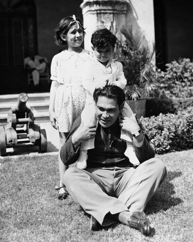 Colonel Fulgencio Batista, Cuba's strong man, playing with his children at his Havana home, on March 14, 1937.